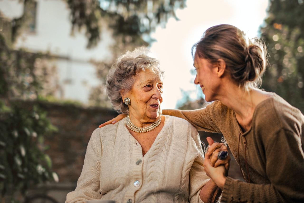 joyful-adult-daughter-greeting-happy-surprised-senior-mother